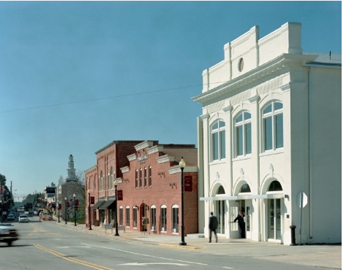 A shot of the Apex historical mainstreet lined with brick buildings and parked cars