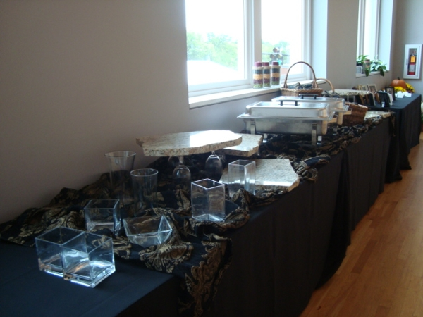 A reception table full of food set up as a buffet